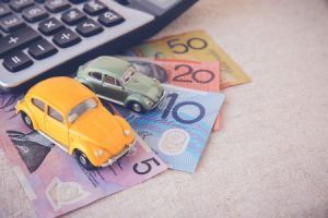 toy cars with aud australian money and calculator