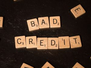 bad credit spelled out on scrabble tokens